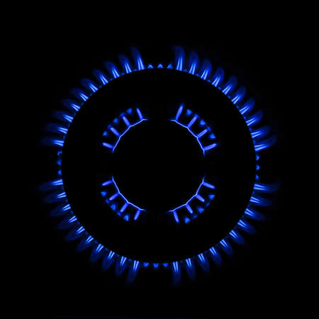 Blue flames from burner Stock Photo