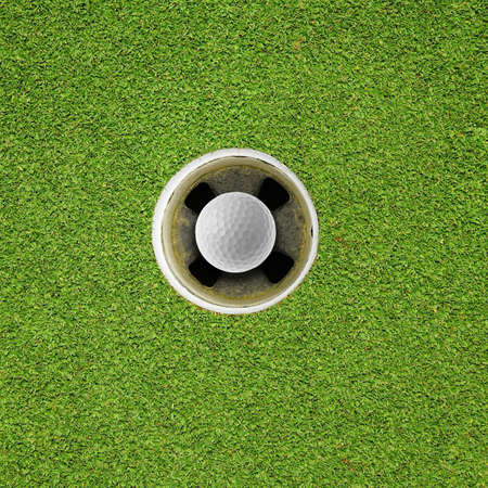 Golf ball in hole Stock Photo - 16272963