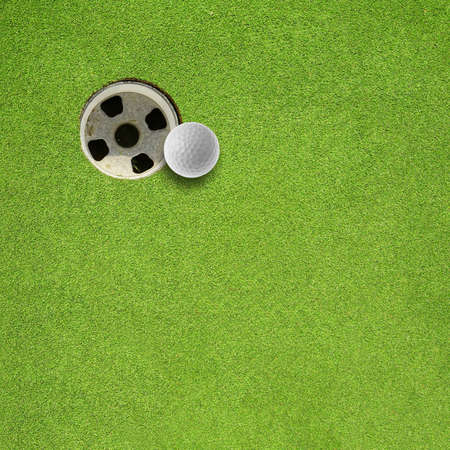 golf ball hole on a field Stock Photo - 16272964