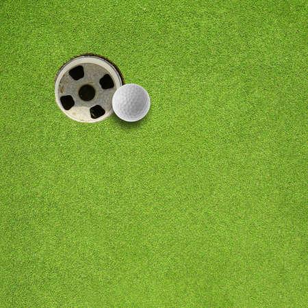 golf hole: golf ball hole on a field