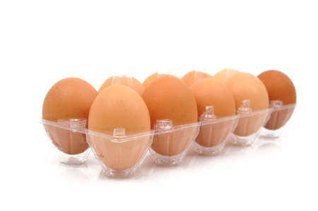 Eggs in plastic box photo