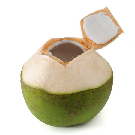 coconut: Beber agua de coco Foto de archivo