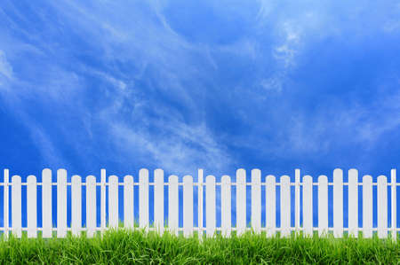 white fence and blue sky photo