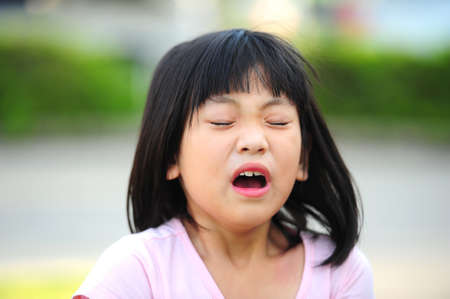 Girl sneezing photo