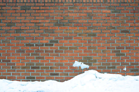 building feature: brick wall with snow