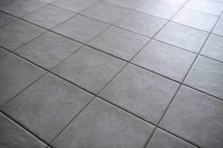 Gray Tiled Floor Reklamní fotografie