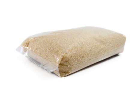 Plastic Bag von Zucker isoliert auf weiß