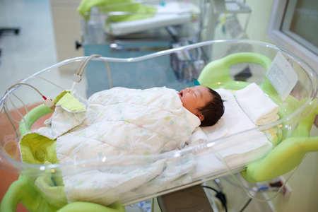 baby nursery: Newborn infant sleeping in hospital bassinet Stock Photo