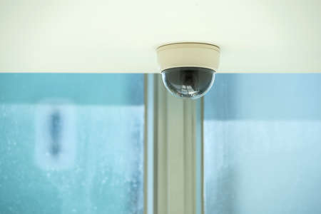 ownership and control: Dome security camera indoors