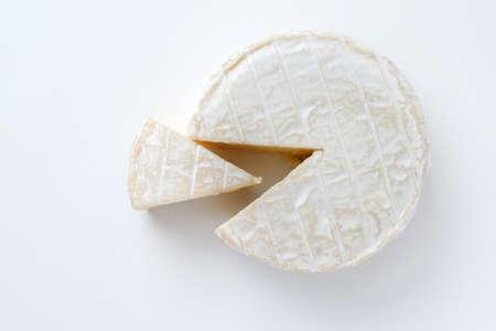 camembert: camembert cheese slice isolated on white
