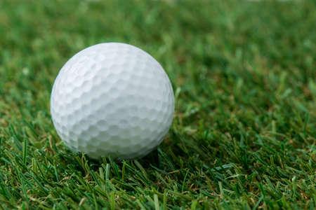 ball: golf ball on green field Stock Photo