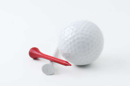 recreational pursuits: golf ball and tee on white background