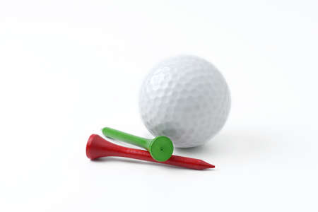 golf ball: golf ball and tee on white background