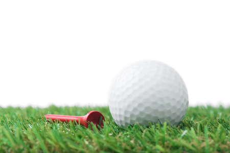 ball: golf ball with tee on grass Stock Photo
