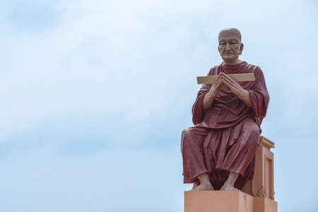 scriptures: monk statue of buddhist recite scriptures