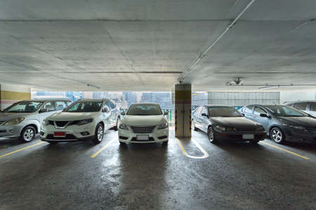 domestic garage: parking lot of high building