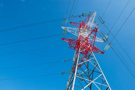 power cables: high voltage power tower pylon and line cables Stock Photo