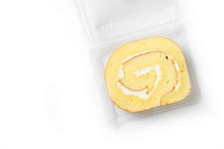swiss roll: swiss roll in plastic box on white background Stock Photo