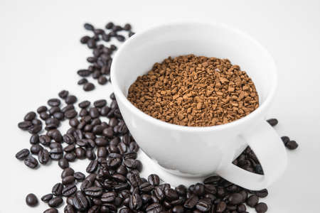 coffe bean: instant coffee in cup with coffe bean