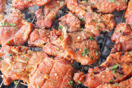 cook griddle: grilled meat on stove Stock Photo