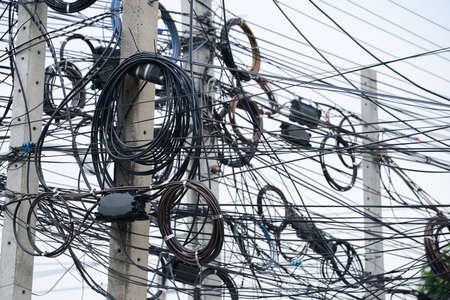 messy: messy electrical cables on pole