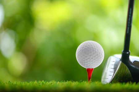 drive a golf ball on tee Stock Photo