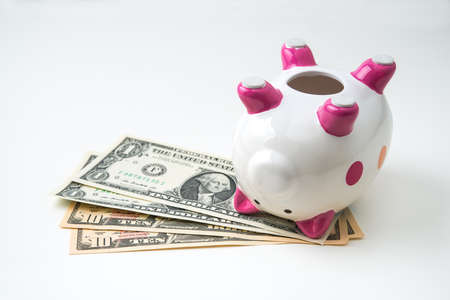 dead piggy bank with money Stock Photo