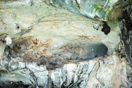 Ancient paintings on cave wall in Phang Nga National Park Thailand Stock Photo - 80033529