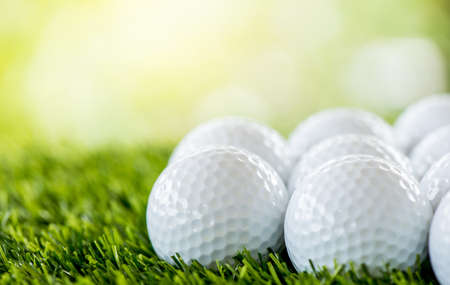 golf ball row on green field