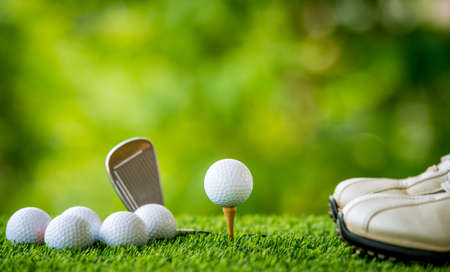 off course: golf ball on tee ready to practice Stock Photo
