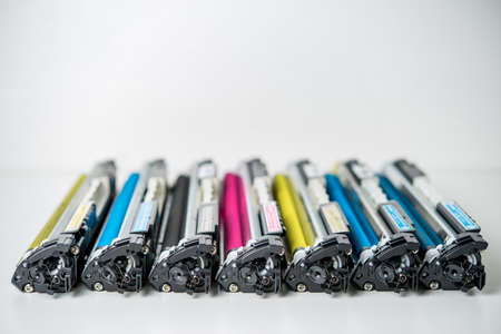 row of used laser toner cartridge
