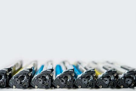 row of used laser toner cartridge