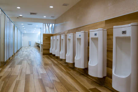 urinal row in a public restroom Stock Photo