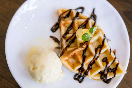 Waffles with ice cream with chocolate and mint leaf Stockfoto