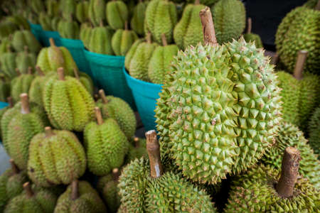 Durian on the basket is shelf in thai fruit market