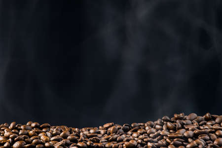 fresh roasted coffee beans with smoke