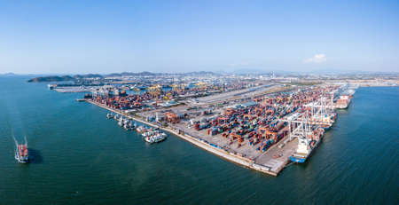 Chonburi, Thailand - February 19, 2018: panorama aerial view of loading cargo container ship port at Sriracha industrial port, Chonburi, Thailand.