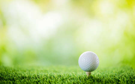 golf ball on tee to tee off Stok Fotoğraf