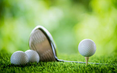 golf ball on tee with club to tee off
