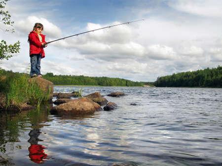 4 year girl fishing on the lake