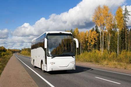 tourist bus, autumn, highway Scandinavia Standard-Bild