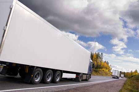 caravan of trucks, highway, truck slightly blurred in motion Standard-Bild