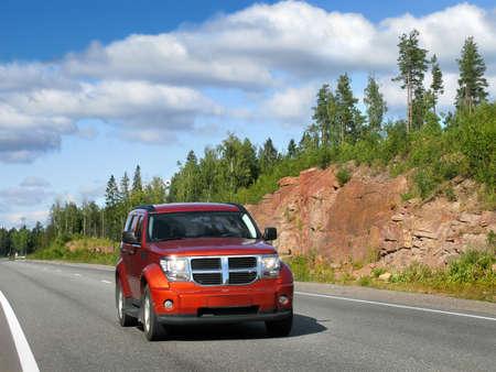 red car on highway Scandinavia Standard-Bild