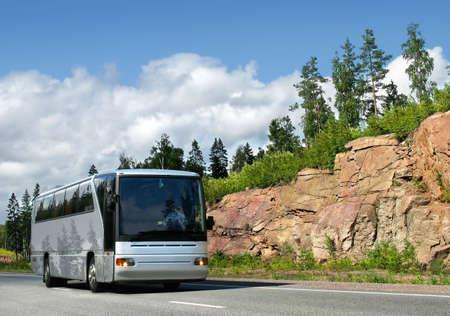sightseeing tour: tourist bus on highway Scandinavia