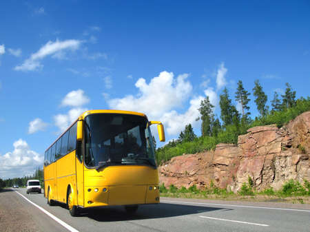 yellow tourist bus on highway Scandinavia