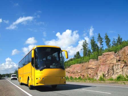 antrey: yellow tourist bus on highway Scandinavia