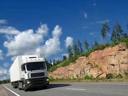 white truck on rocky highway