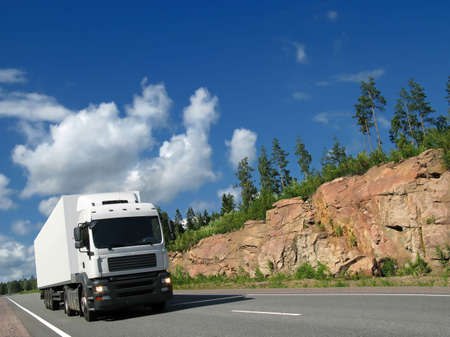 truck on highway: white truck on rocky highway