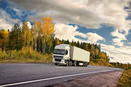 country highway: white truck on autumn highway Stock Photo