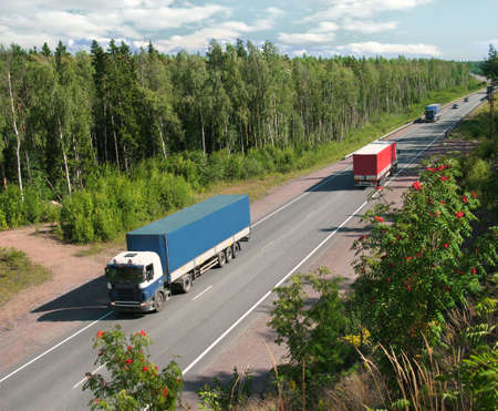 country highway: trucks on summer country highway Stock Photo